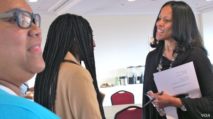 South Carolina lawmaker Mia McLeod, right, chats with students during an Elect Her workshop. At left is Jasmine Gil, chief of staff for the College of Charleston's Student Government Association.