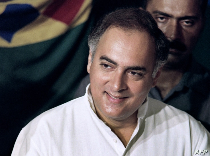 FILE - In this photograph taken on May 20, 1991 National Congress leader Rajiv Gandhi casts his ballot at a polling station in New Delhi for the first round of the general election.
