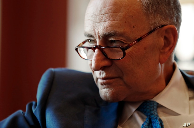 Senate Minority Leader-elect Chuck Schumer of  New York, speaking to the AP at his Capitol Hill office, Nov. 18, 2016, says Jeff Sessions will face tough questions during confirmation hearings on his selection as attorney general.
