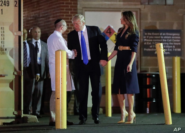 President Donald Trump and first lady Melania Trump talk with Dr. Ira Y. Rabin, left, after visiting MedStar Washington Hospital Center in Washington, June 14, 2017, where House Majority Leader Steve Scalise of La. was taken after being shot in Alexa...