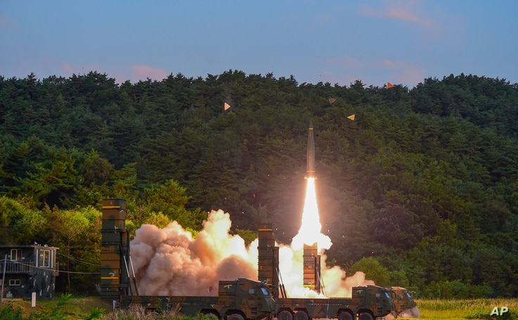 In this photo provided by South Korea Defense Ministry, a Hyunmoo II ballistic missile is fired during an exercise at an undisclosed location in South Korea, Sept. 4, 2017. South Korea's military said it conducted a live-fire exercise simulating an a