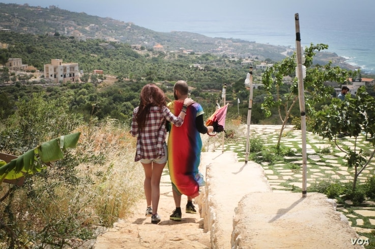 Paul Eshac (right) and his friend enjoy the scenery during a Beirut Pride event this weekend, May 21, 2017. (J. Owens/VOA)