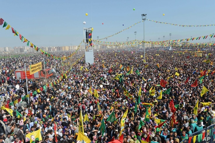 Thousands of supporters demonstrate as jailed Kurdish rebel leader Abdullah Ocalan called for a cease-fire, Diyarbakir, Turkey, March 21, 2013.