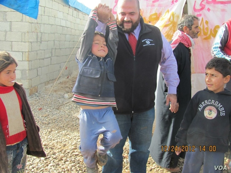 Mohamed Khairullah visits Atmah Refugee camp in 2014 (Photo: Courtesy Mohamed Khairullah)