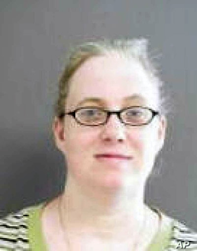 This undated photo provided by the Texas Department of Public Safety via the Houston Chronicle shows Julia Poff, a woman accused of mailing potentially deadly homemade bombs to then-President Barack Obama and Texas Gov. Greg Abbott in 2016. Poff was ...