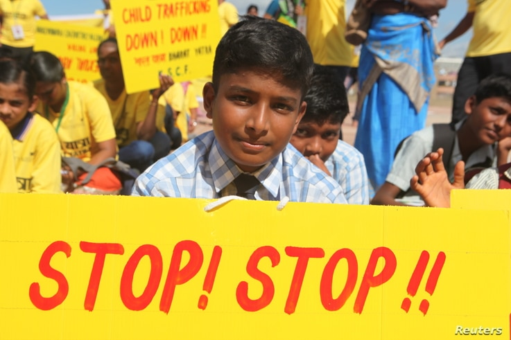 A schoolboy holds a sign calling for end of child trafficking and sex abuse at an event to kick off what is expected to be the world's largest march against such crimes in Kanyakumari in India's Tamil Nadu state, Sept 11, 2017.