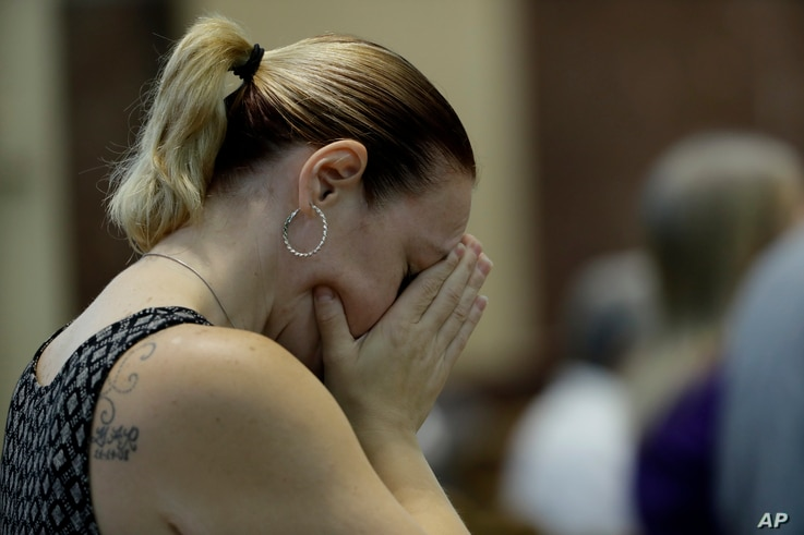 A parishioner attends mass celebrated by Bishop Ronald Gainer, of the Harrisburg Diocese, at the Cathedral Church of Saint Patrick in Harrisburg, Pa., Aug. 17, 2018.