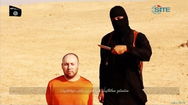 FILE - A masked, black-clad militant, identified by The Washington Post newspaper as a Briton named Mohammed Emwazi, stands next to a man purported to be Steven Sotloff in this still image from a video obtained from SITE Intel Group website, Feb. 26,