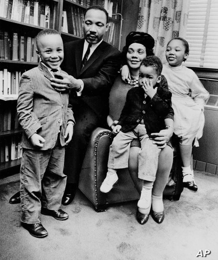 FILE - In this March 17, 1963, file photo, Dr. Martin Luther King Jr. and his wife, Coretta Scott King, sit with three of their four children in their Atlanta, Ga., home. From left are: Martin Luther King III, 5, Dexter Scott, 2, and Yolanda Denise, ...