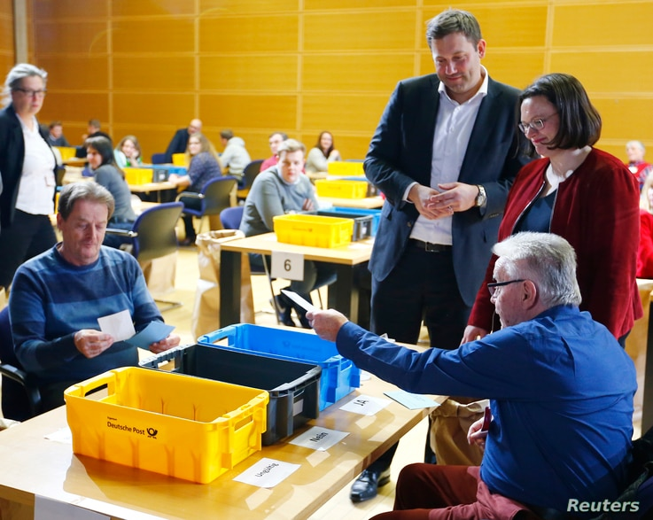 FILE - Andrea Nahles, right, and Lars Klingbeil of Social Democratic Party look on as party members count ballot papers of the voting for a possible coalition between the SPD and the Christian Democratic Union (CDU) in the SPD headquarters in Berlin,...