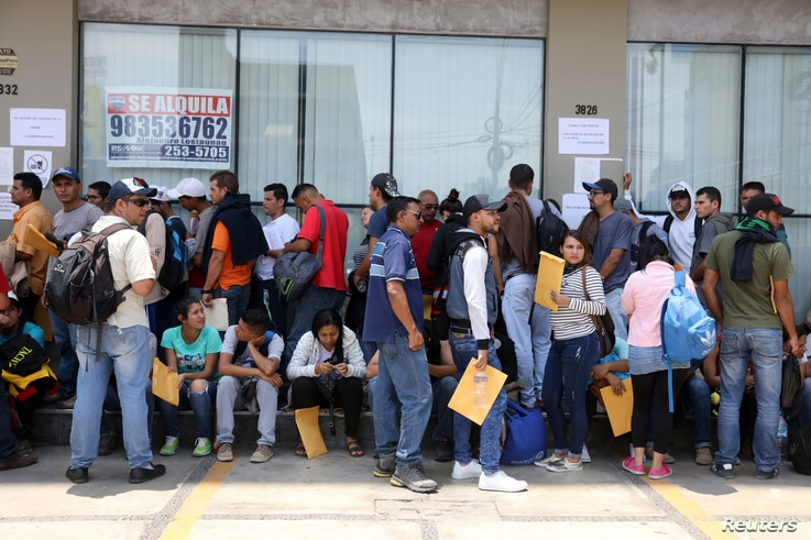 Venezuelans who fled their homeland line up for temporary residence permits in Lima, Peru, Jan.  23, 2018.