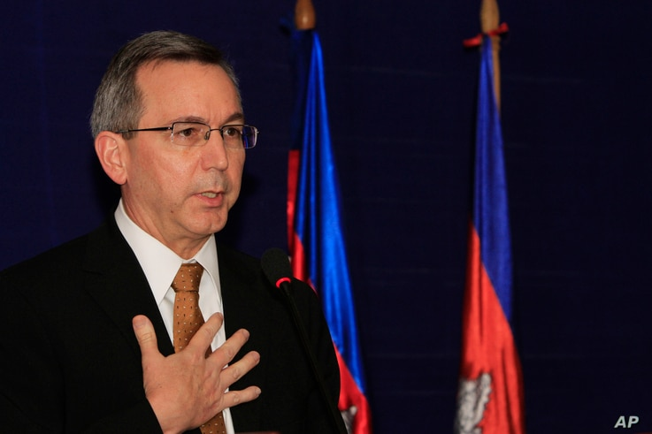 FILE - U.S. Principal Deputy Assistant Secretary of State for East Asian and Pacific Affairs Scot Marciel gestures during a press conference in Phnom Penh, Cambodia, Nov. 4, 2013.
