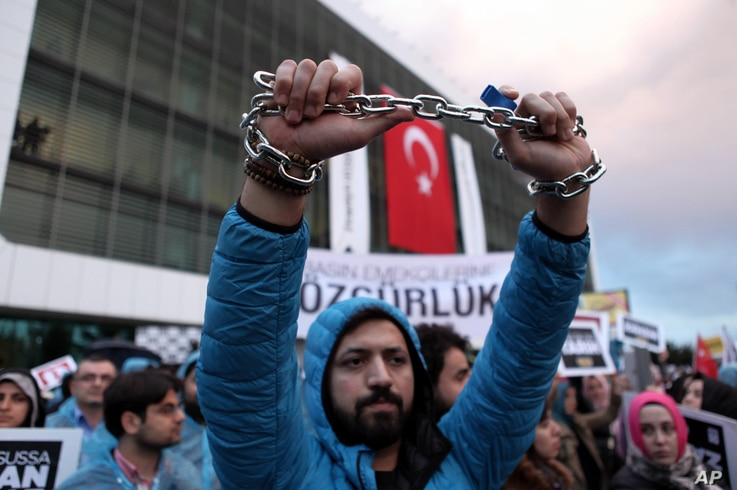 Thousands of people gather in solidarity outside Zaman newspaper in Istanbul, after a local court ordered that Turkey's largest-circulation, opposition newspaper be placed under the management of trustees, March 4, 2016.