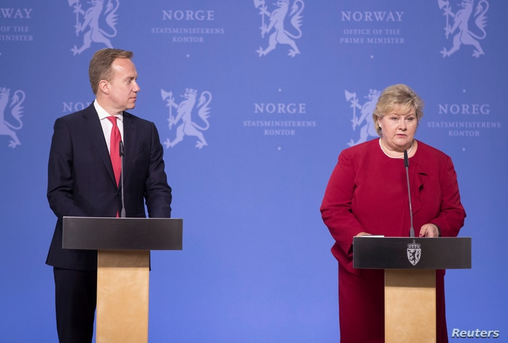 Norway's Prime Minister Erna Solberg, right, and Foreign Minister Borge Brende speak at news conference after the release of Norwegian-British national Joshua French from a Congo prison, in Oslo, Norway, May 17, 2017.