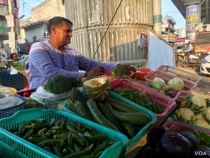 Fruit vendor Khubi Ram switched to selling vegetables after the currency ban in November when business dried up.