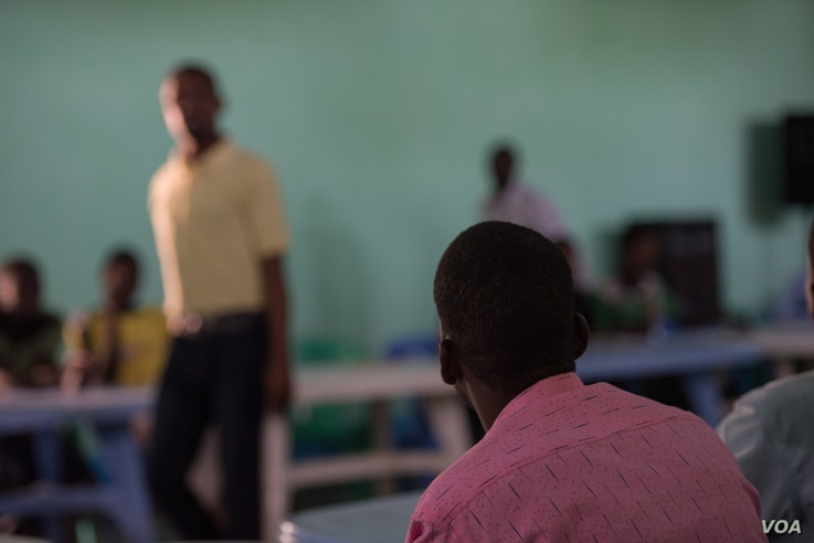 A teacher, himself a former Al Shabab member, instructs fellow defectors at a rehabilitation center for former militants in Baidoa, Somalia, Sept. 17, 2016. (Photo: J. Patinkin/VOA)