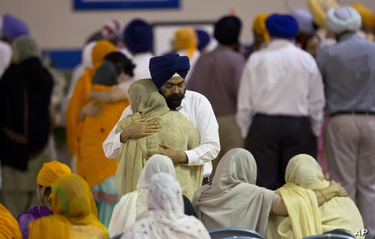 Mourners at the funeral and memorial service for the six Sikh worshippers killed at their temple in Oak Creek, Wisconsin, August 10, 2012.