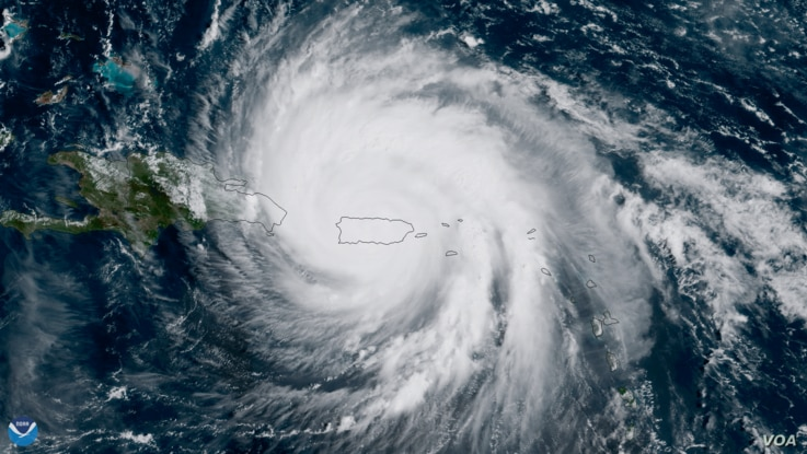 The center of Hurricane Maria approaches the northern coast of Puerto Rico in this geocolor image captured by NOAA's GOES-16 on September 20, 2017.
