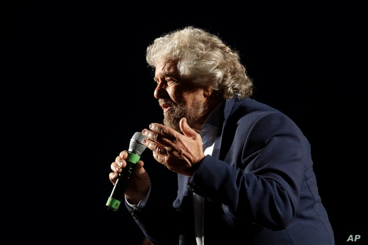 """Five Stars Movement party leader Beppe Grillo speaks at a rally on constitutional reforms, in Rome, Italy, Nov. 26, 2016. He has called Italy under Prime Minister Matteo Renzi """"a country that's stuck in the mud."""""""