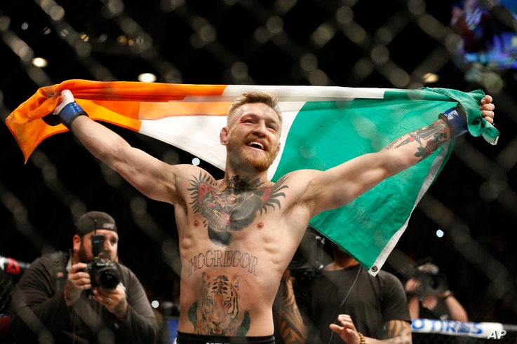 FILE - Conor McGregor reacts after defeating Jose Aldo during a featherweight championship mixed martial arts bout at UFC 194 in Las Vegas, Dec. 12, 2015.