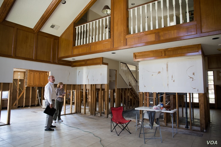 Rob Hellyer, owner of Premier Remodeling & Construction, evaluates reconstruction progress inside Kathryn Clark's two-story home.