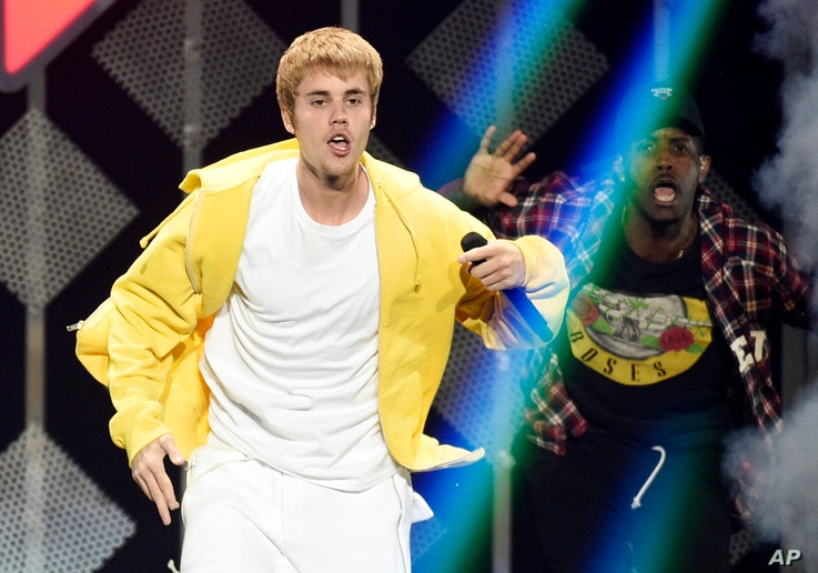 FILE - Justin Bieber performs at the 2016 Jingle Ball at Staples Center in Los Angeles.