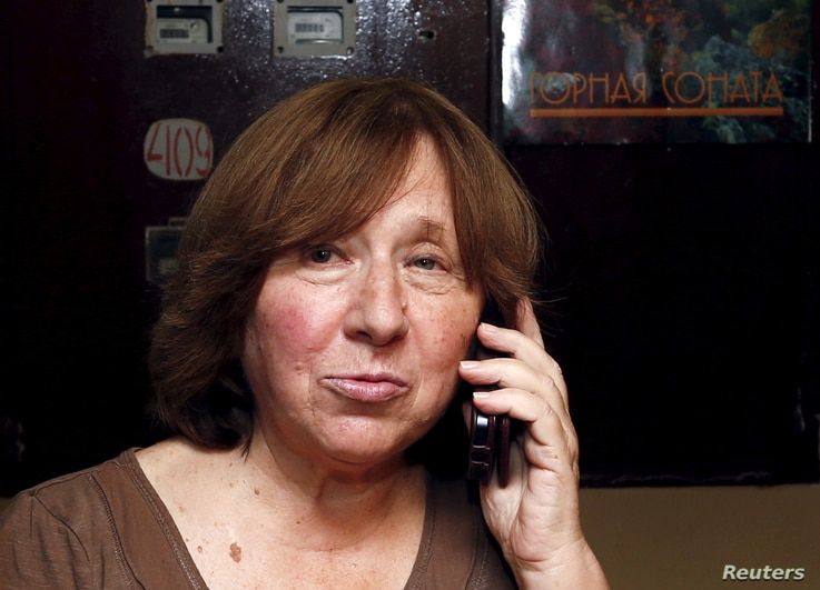 Belarussian author Svetlana Alexievich speaks on the phone as she walks out of her apartment in Minsk, Belarus, Oct. 8, 2015.