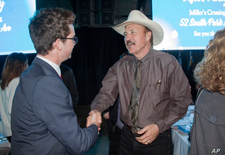 FILE - Congressional candidate Rob Quist meets with supporters during the annual Mansfield Metcalf Celebration dinner hosted by the state's Democratic Party in Helena, Mont., March 18, 2017.