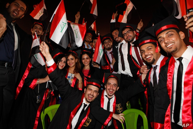 FILE - Baghdad University graduates wave national flags as they celebrate during a graduation ceremony in Baghdad, Iraq, July 14, 2012.