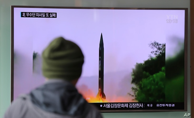 "A man in South Korea watches a TV news program showing a missile launch conducted by North Korea, Oct. 20, 2016. The U.S. military says called the event a ""failed"" North Korean missile launch."