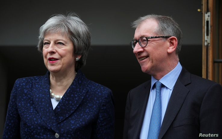 Britain's Prime Minister Theresa May and her husband, Philip, leave after voting in local government elections in London, May 3, 2018.