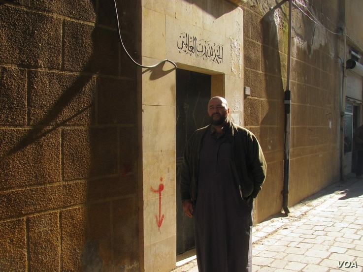 "Mohamed Khairullah in front of his family's home in Aleppo, Syria, where his third great-grandfather is buried. ""The area is almost completely deserted now,"" he said. (Photo: Courtesy Mohamed Khairullah)"