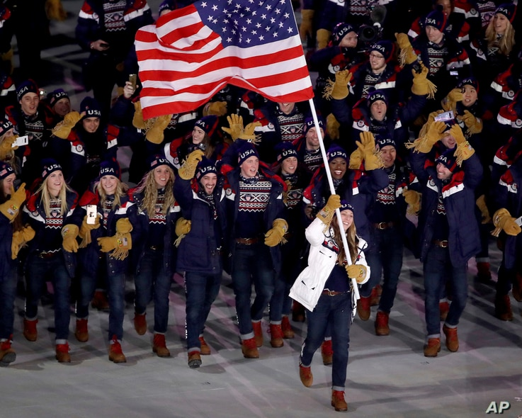Erin Hamlin carries the flag of the United States during the opening ceremony of the 2018 Winter Olympics in Pyeongchang, South Korea, Feb. 9, 2018