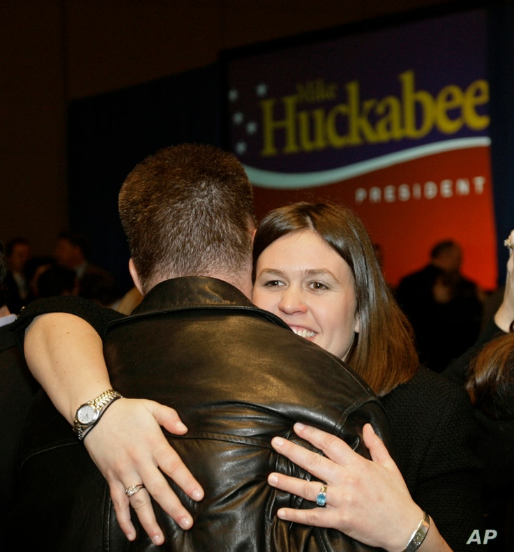 Sarah Huckabee, the daughter of Republican presidential hopeful, former Arkansas Gov. Mike Huckabee, hugs a friend at her father's election watch party in Columbia, S.C., Jan. 19, 2008.