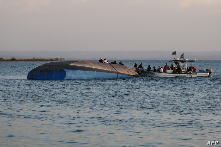 Investigators examine the capsized ferry MV Nyerere, in Lake Victoria, Tanzania, Sept. 21, 2018.