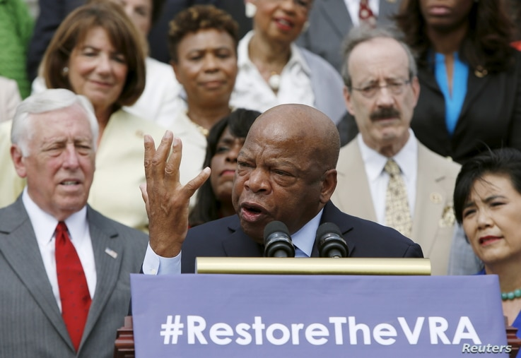 Congressman John Lewis joined several dozen other Democrats at a news conference outside the U.S. Capitol to urge restoring a shelved Voting Rights Act protection, July 30, 2015.