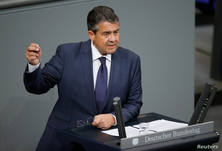FILE - German Foreign Minister Sigmar Gabriel speaks during a session of the Bundestag, Germany's lower house of Parliament, in Berlin, Germany, Nov. 21, 2017.