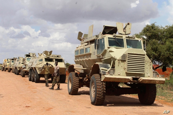 FILE - African Union soldiers stop near to Beledogle airfield, Somalia, to help secure the area from al-Shabab insurgents, Oct 11, 2012.
