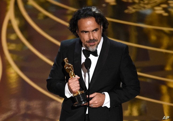 """Alejandro G. Inarritu accepts the award for best director for """"The Revenant"""" at the Oscars on Feb. 28, 2016, at the Dolby Theatre in Los Angeles."""