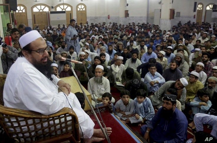 Pakistani leric Hafiz Saeed, the founder of the outlawed Lashkar-e-Taiba group, addresses at a mosque in Lahore, Nov. 1, 2018. Saeed urged followers to hold rallies across the country on Friday to condemn the Supreme Court decision that acquitted Asi...
