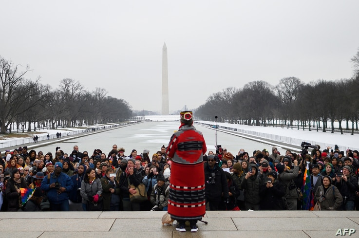 A woman speaks during the Indigenous Peoples March on the National Mall at the Lincoln Memorial in Washington, Jan. 18, 2019.