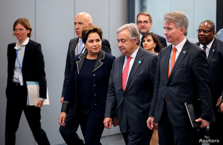 Patricia Espinosa, Executive Secretary of the United Nations Framework Convention on Climate Change, and U.N. Secretary-General Antonio Guterres arrive for the opening of the High-Level Segment of COP23 U.N. Climate Change Conference in Bonn, Germany...