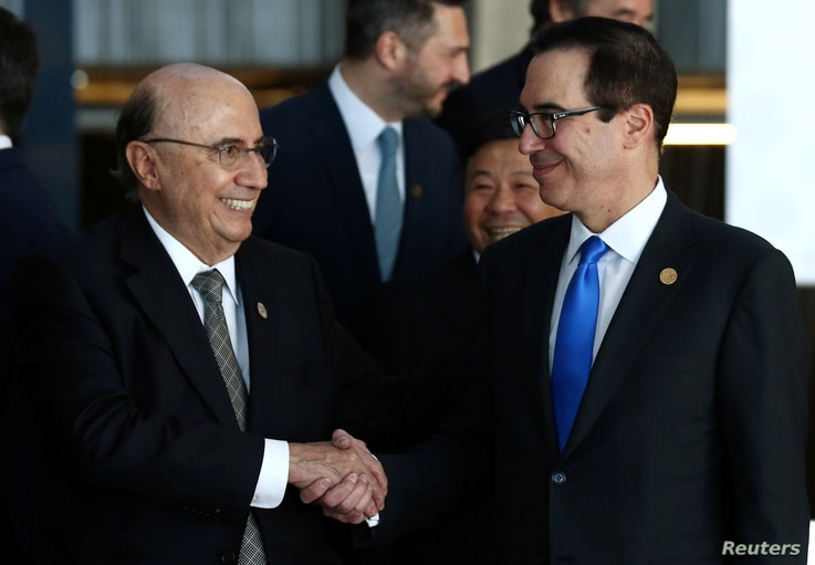 U.S. Secretary of the Treasury Steven Mnuchin and Brazil's Finance Minister Henrique Meirelles shake hands after posing for the official photo at the G20 Meeting of Finance Ministers in Buenos Aires, Argentina, March 19, 2018.