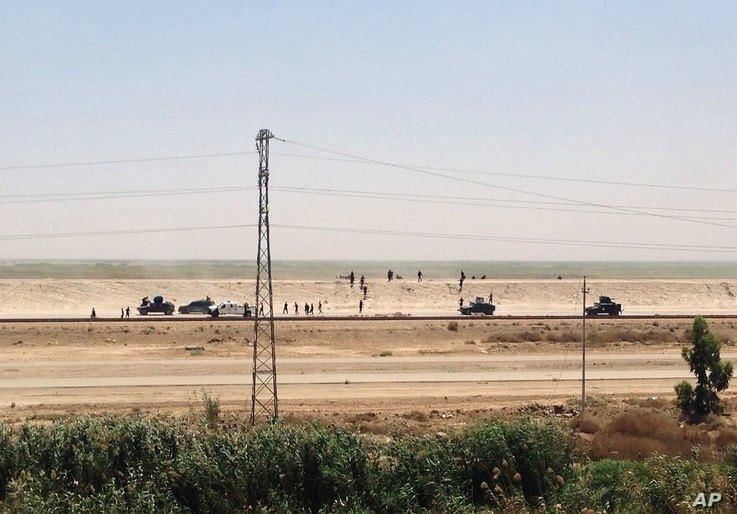 Iraq security forces withdraw from Ramadi, the capital of Iraq's Anbar province, 115 kilometers (70 miles) west of Baghdad, Sunday, May 17, 2015.