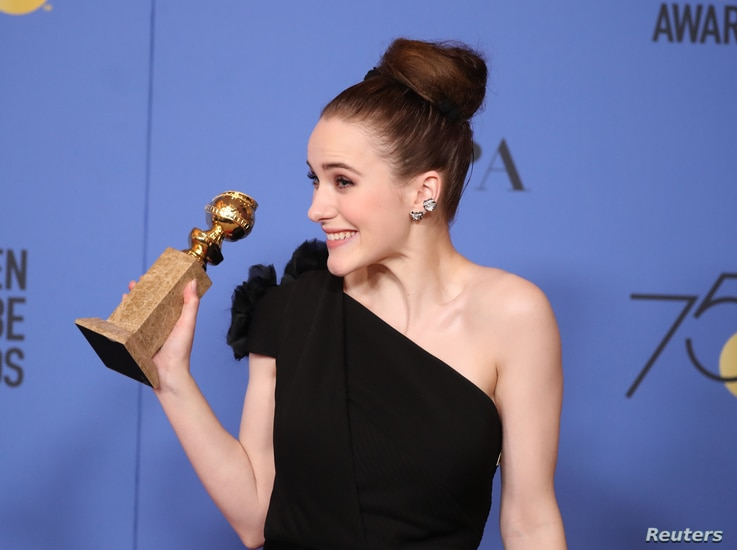 """Rachel Brosnahan poses backstage at the 75th Golden Glob Awards, Jan. 7, 2018, with her Globe for Best Actress in a Television Series, Comedy or Musical for the Amazon series """"The Marvelous Mrs. Maisel."""""""