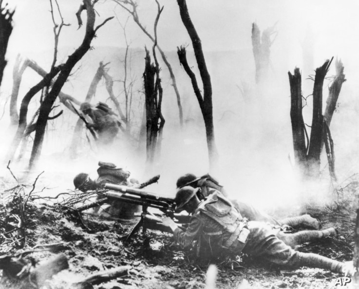 FILE - A U.S. Army 37-mm gun crew man their position during the World War I Meuse-Argonne Allied offensive in France, Sept. 26, 1918.