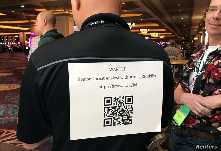 A recruiter advertises a QR code to attract hackers to apply for jobs at the Black Hat security conference in Las Vegas, Nevada, U.S. July 27, 2017.