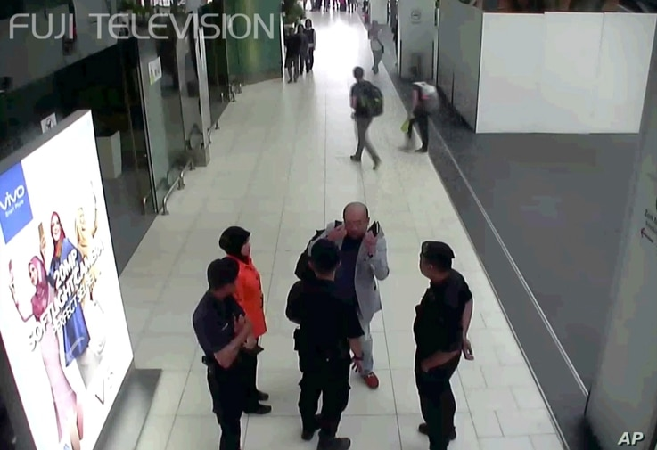 In this image made from airport closed circuit television video and provided by Fuji Television, Kim Jong Nam, exiled half-brother of North Korea's leader Kim Jong Un, gestures towards his face while talking to airport security and officials at Kuala...