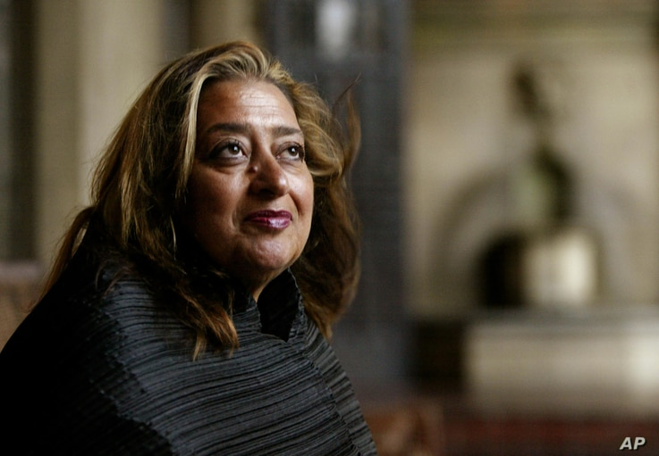 FILE- Iraqi-British architect Zaha Hadid poses in West Hollywood, California, March 21, 2004. Hadid, whose modernist, futuristic designs included the swooping aquatic center for the 2012 London Olympics, died aged 65, Thursday, March 31, 2016.