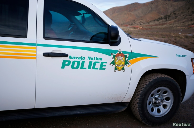 A Navajo police officer patrols in his vehicle on the Navajo Reservation, by a remote section of the Grand Canyon near Little Colorado River, Arizona June 23, 2013